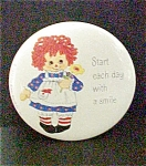 Click here to enlarge image and see more about item P116: Red Headed Rag Doll Pin-Back