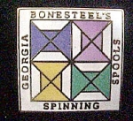 Click here to enlarge image and see more about item P148: Georgia Bonesteel's Spools Spinning Lapel Pin