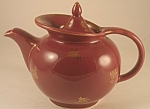 "Maroon six-cup tea pot with gold rose decorations in Hall's ""Windshield"" shape. In good shape, but with some wear in areas you'd expect: on the handle (worn gold on handle, tip of lid and on..."