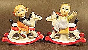 Figurines - Boy and Girl On Rocking Horses - Pair (Image1)