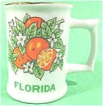 Click here to enlarge image and see more about item AAA195: Porcelain Florida Souvenir Mug Toothpick