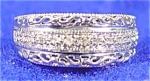 Click here to enlarge image and see more about item AAA236: 10 K White Gold Diamond MOM Ring - Size 7