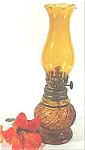 Click here to enlarge image and see more about item AAA270: Amber Glass Miniature Oil Lamp ~ Hong Kong 8 in ~