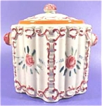 Here is a beautiful antique cookie or biscuit jar for your consideration. It is six-sided and has handpainted roses on it. In very nice condition for the age. It has fine crazing as is normal for this...
