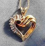 Click here to enlarge image and see more about item AAA848: 10K Y.G. Diamond Heart Pendant - 5 Baguettes