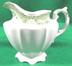 Click here to enlarge image and see more about item B11: Green Transferware Cream Pitcher - England
