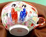 Click here to enlarge image and see more about item B333: Oriental 6 Geisha Tea Cup - Orange Border