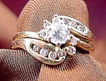 Click to view larger image of 14K Y.G. Diamond Wedding Ring Set - Size 5.5 (Image1)