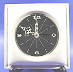 Click here to enlarge image and see more about item B385: Ceramic Battery Wall Clock - White