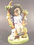 Click here to enlarge image and see more about item B492: Figurines - Bisque Boy with Dog - Hummel Style