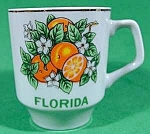 Click here to enlarge image and see more about item B882: Florida Souvenir Cup with Oranges - Miniature