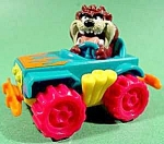 Click here to enlarge image and see more about item C211: TAZ Driving A Car ~ McDonald's Happy Meal Toy