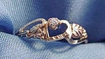 Click here to enlarge image and see more about item C350: 10K Black Hills Gold Diamond Ring - Size 7