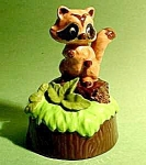Click here to enlarge image and see more about item C367: Baby Raccoon ceramic Figurine