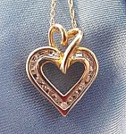 Click here to enlarge image and see more about item C413: 10K Y.G. Diamond Heart Pendant on 18 inch Chain