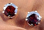Click here to enlarge image and see more about item C420: 14K Y.G. Garnet Earrings - Pierced