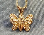 Click here to enlarge image and see more about item C482: Diamond Butterfly Pendant - 14K Yellow Gold