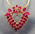 Click here to enlarge image and see more about item C485: 10K Yellow Gold Ruby Heart Pendant - Mirror Box Chain