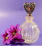 Click here to enlarge image and see more about item C703: Glass Perfume Bottle with Silver Heart Stopper