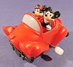 Click here to enlarge image and see more about item C704: Mickey & Minnie White Knob Windup Toy - Disney