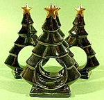 Click here to enlarge image and see more about item C709: Ceramic Christmas Tree Napkin Rings - Set of 4