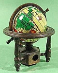 Click here to enlarge image and see more about item C775: Metal Globe on Stand Pencil Sharpener