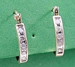 Click here to enlarge image and see more about item C802: Petite White Sapphire Hoop Earrings - Pierced