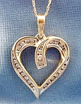Click here to enlarge image and see more about item C803: Heart Pendant with Diamonds - 10K Y.G. - 18 inch Chain