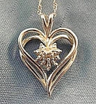 Click here to enlarge image and see more about item C901: 10K White Gold Heart Pendant - 18 inch Chain