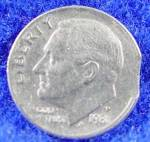 Click here to enlarge image and see more about item D244: Roosevelt Dime 1981-P Clipped Planchet Coin