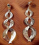 Click here to enlarge image and see more about item D39: 14K Y.G. Dangle Earrings - Pierced