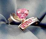 Click here to enlarge image and see more about item D522: 10K W.G. Pink Topaz Ring - Size 6.5