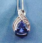 Click here to enlarge image and see more about item D717: Blue Topaz 10K W.G. Pendant - 18 inch Chain