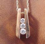 10K Y.G. Diamond Pendant - 18 inch Chain
