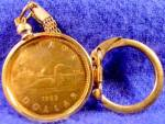 Click here to enlarge image and see more about item D869: Canada Loon Dollar Coin 1989 - Keychain