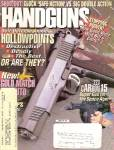 Click here to enlarge image and see more about item B1359: Handguns - february 1998
