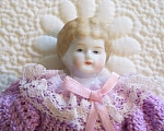 Click here to enlarge image and see more about item DOLL3: CHINA HEAD~VINTAGE~DOLL~ 9 INCHES TALL