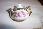 Click here to enlarge image and see more about item ECH011003G1: Vintage Child's Gold Flower Porcelain Teapot