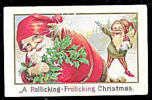 1910 Santa Claus With Elf & Bag Frolicking Postcard