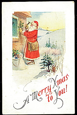 Santa Claus Nailing Holly 1912 Postcard (Image1)