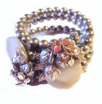 Click here to enlarge image and see more about item 000BRA384: 1950s Blue Silver Faux Pearl Floral Wrap Bracelet