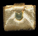 Click here to enlarge image and see more about item 000COMP39: 1950s Gold Tone Compact in Mesh Clutch
