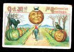 Click here to enlarge image and see more about item 000HALLO549: Walking JOL & Black Cat Halloween 1909 Postcard