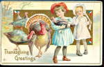 Click here to enlarge image and see more about item 000TG007: 1913 Thanksgiving Greetings Children w Turkey Postcard