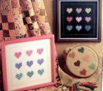 Click here to enlarge image and see more about item 000XST8: Home Spun 'Charmed Hearts' Cross Stitch Patterns