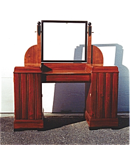 A Mahogany And Ebonized Mirror