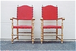 Click here to enlarge image and see more about item 203: A pair of Gold painted armchairs.