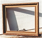 A gilt wood picture frame