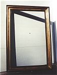 A Large Gilded/Ebonized Mirror