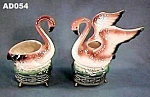Click here to enlarge image and see more about item AD054: Pair of Flamingo Planters on Metal Bases
